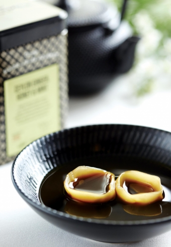 TEA CONSOMMÉ WITH CONFIT DUCK LEG TORTELLINI