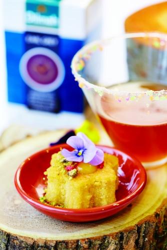 HONEY GLAZED SPONGE CAKE WITH LEMON CURD, PISTACHIO & BAKED STRAWBERRIES