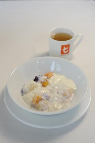 Yoghurt and fruit , lightly sweetned