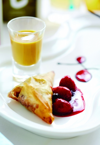 BANANA PARCEL SERVED WITH DILMAH ROSE AND FRENCH VANILLA TEA CUSTARD AND BERRY SAUCE