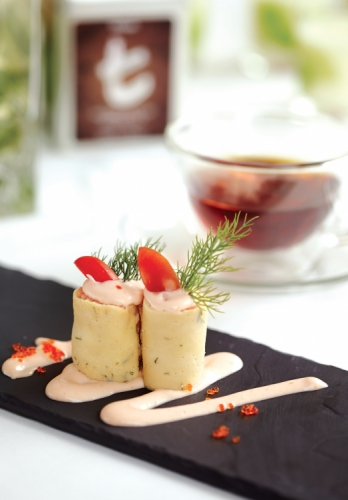 SMOKED SCOTTISH SALMON ROLLED WITH CREAM CHEESE AND AROMATIC THAI HERBS