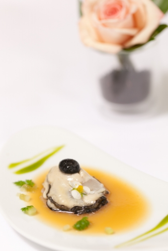 TeMatuku oyster with spiced almond tea jelly, black garlic pearl and melon